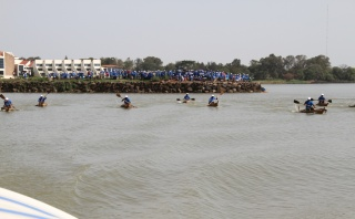 The competition being watched by hundreds of spectators from all sides of the lake